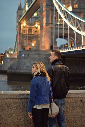 Two People Togetherness Onedestination Architecture Real People Love Night London Tower Bridge  Lights Lifestyles Romance Serious Couple Relationship Tower Bridge  Outfitoftheday Outdoors City Together Distance Fashion Stories Adventures In The City
