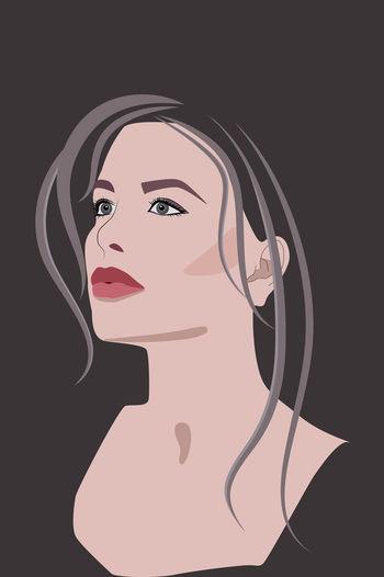 Close-up portrait of woman against black background