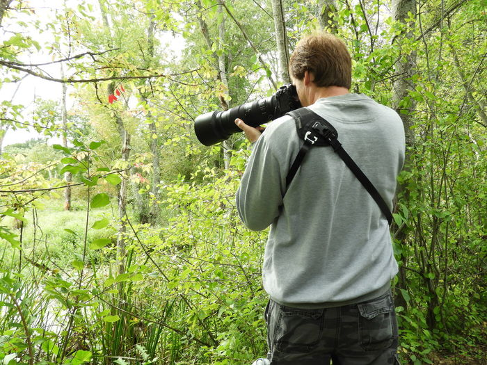 Man With Camera Photographing Nature Camera One Man Taking Photographs Beauty In Nature Nature Photography Nature Nature Photography Ipswich River Wildlife Sanctuary Enjoying Nature Standing Tranquility