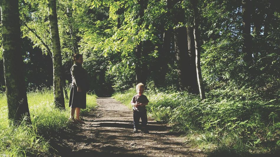 3XSPUnity this is family 3XSPhotographyUnity 3XSPUnity EyeEm Nature Trees Tree Trunk Tree Area Forest Photography Beauty In Nature Tree Full Length Childhood Child Standing Shadow Women Grass