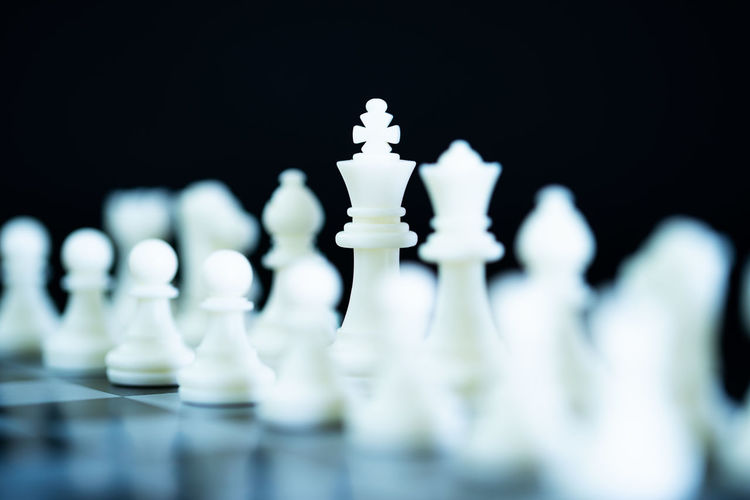 Close-up of chess pieces against blurred background