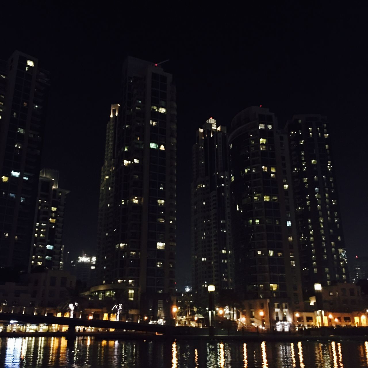 illuminated, night, architecture, building exterior, skyscraper, built structure, city, modern, no people, cityscape, low angle view, tall, outdoors, sky, water