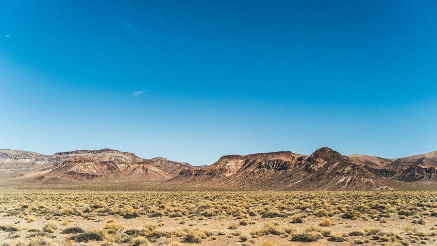 Arid mountains landscape against clear blue sky in nevada in high desert
