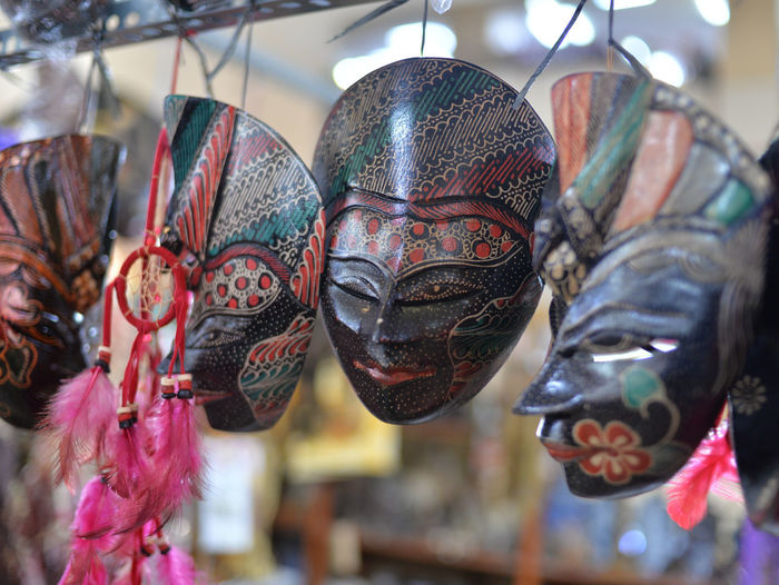 Close-up of mask for sale at market