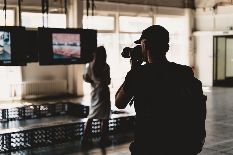 Berlin Photo Week 2018 Berlin Photo Week BPW18 EyeEem Indoors  Real People Technology Occupation Screen Standing Rear View Men Adult People Device Screen Working Three Quarter Length Communication Photography Themes Arts Culture And Entertainment Women Lifestyles Photographer Video