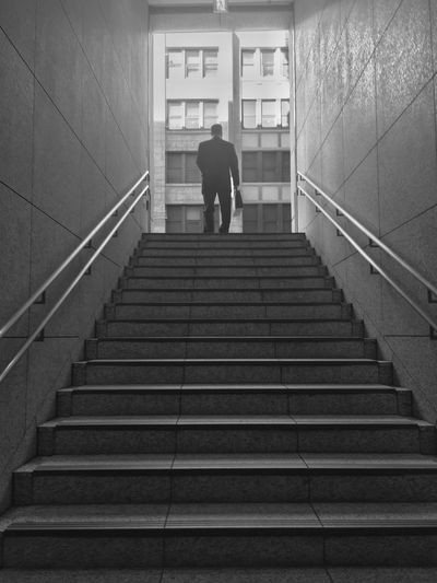 Low angle view of businessman standing by staircase