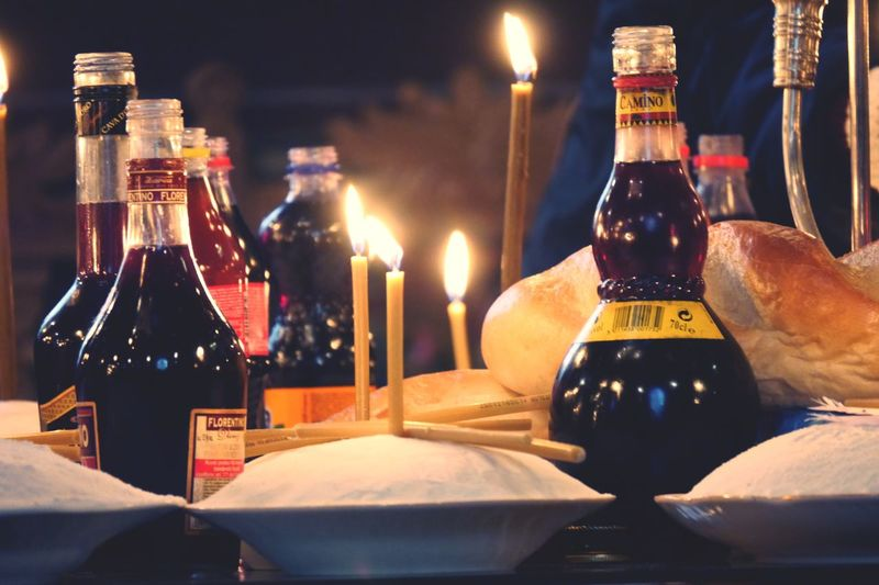 Alms Giving Orthodoxy Illuminated Food And Drink Bottle No People Text Refreshment Alcohol Western Script Close-up Freshness Table Still Life Communication Drink Indoors  Candle Night Container Wine Glass - Material