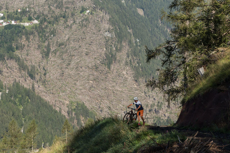 Man riding motorcycle on mountain road