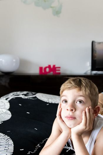 Portrait of boy smiling at home