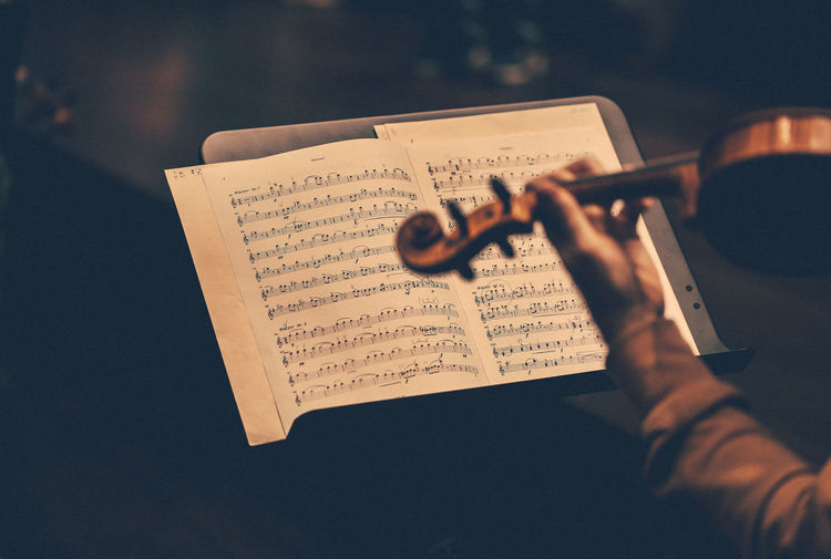 Soulful tunes Human Hand Hand Holding Human Body Part One Person Paper Sheet Music Real People Music Sheet Activity Arts Culture And Entertainment Communication Leisure Activity Men Publication Text Indoors  Selective Focus Finger Violin Concert