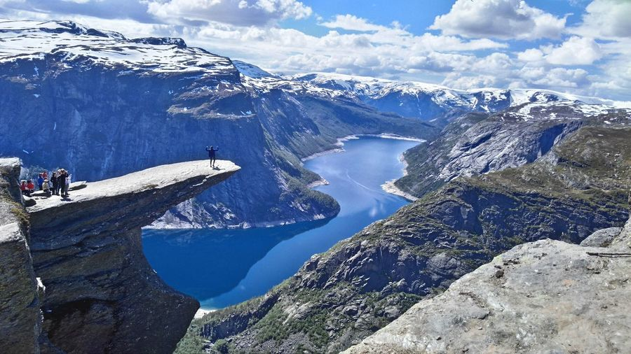 High Angle View Of People At Trolltunga Against Mountains