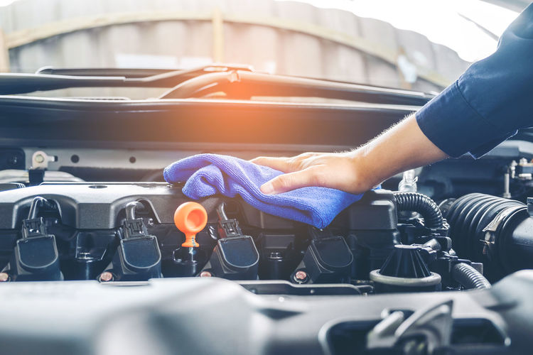 Auto Repair Shop Car Car Wash Cleaning Close-up Day Engine Human Body Part Human Hand Indoors  Land Vehicle Mechanic Men Mode Of Transport Occupation One Person Real People Repairing Service Technology Transportation