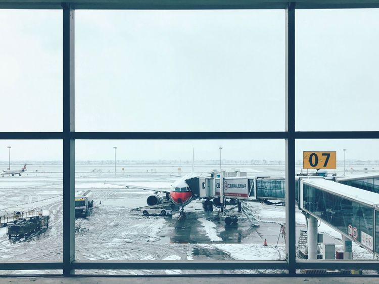 Transportation Mode Of Transport Land Vehicle Day Car Sky Snow Winter Cold Temperature Outdoors Built Structure Architecture Nature City No People Passenger Boarding Bridge Airplane Airport Long Goodbye