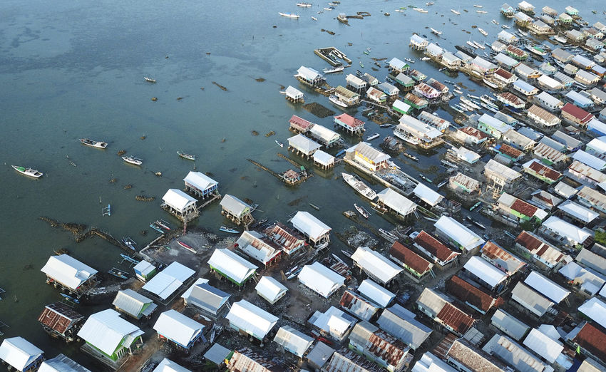 Aerial view of stilt houses in sea
