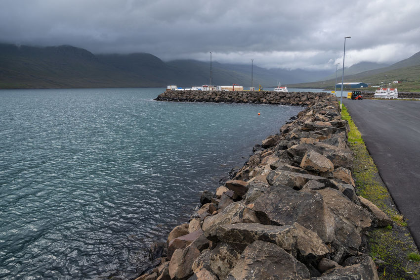 Beautiful Nature Iceland Rock Stone Wall Architecture Atemberaubende Natur Beauty In Nature Blue Water Cloud - Sky Day Fjord Fjord Port Foggy Clouds Groyne Iceland 2018 Iceland Fire And Ice Island Island 2018 Island Fjord Island Insel Aus Feuer Und Eis Lava Rock Mountain Nature Nautical Vessel No People Outdoors Rock Rock - Object Rock Stones Sailboat Scenics - Nature Sea Silent Moment Sky Solid Street Tranquil Scene Tranquility Transportation Viking Island Water Capture Tomorrow