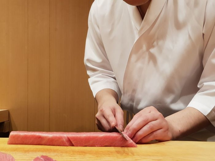 chef's preparation EyeEm Selects Human Hand Women Close-up Chopping Kitchen Knife Cutting Kitchen Counter Knife Chef Chef's Whites Prepared Food Cutting Board Preparing Food