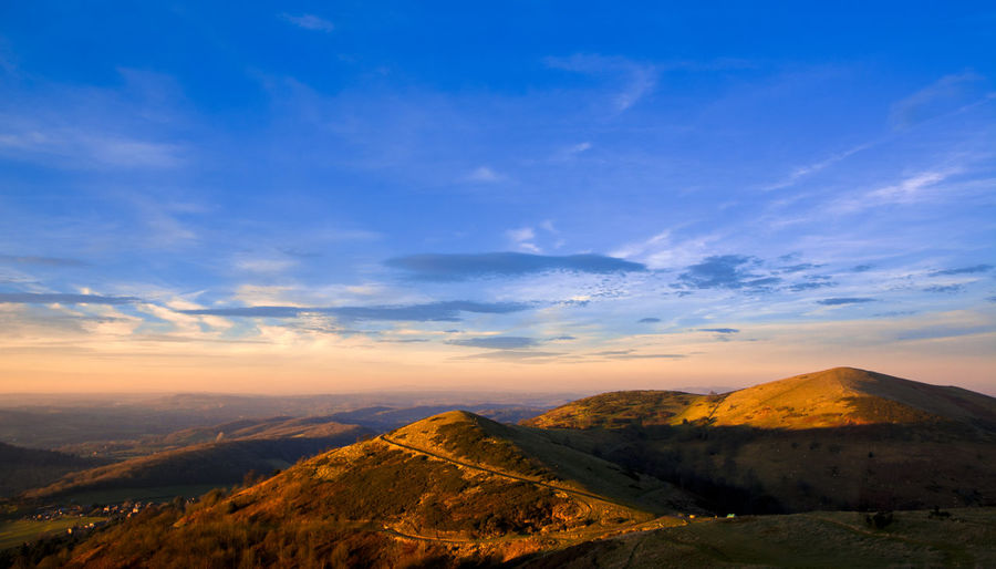 Vivid sunset Malvern Hills Sunset_collection Arid Climate Beauty In Nature Blue Cloud - Sky Environment Idyllic Land Landscape Mountain Mountain Peak Mountain Range Nature No People Non-urban Scene Orange Color Outdoors Remote Scenics - Nature Sky Sunset Tranquil Scene Tranquility