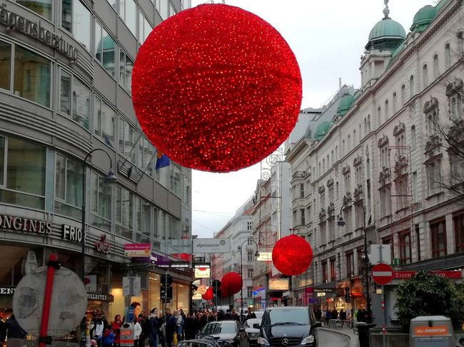 Xmas Decorations Xmas Ornaments Happy Holidays Red Colour Red Balloon Xmas Shopping Xmas Time Vienna Architecture Building Exterior City Built Structure Red City Street City Life