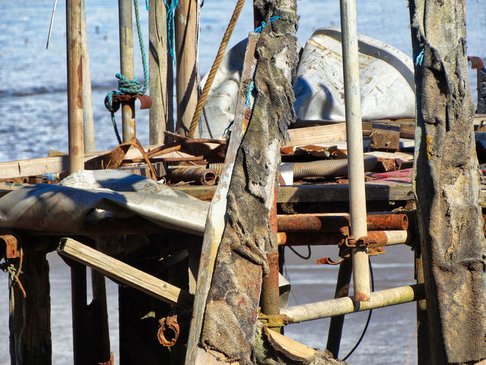 Wooden planks on jetty. Standing Damaged Old Water Wood - Material Nautical Vessel Transportation No People Day Sea Nature Mode Of Transportation Abandoned Architecture Rusty Outdoors Built Structure Metal Obsolete Jetty Wooden Wooden Post