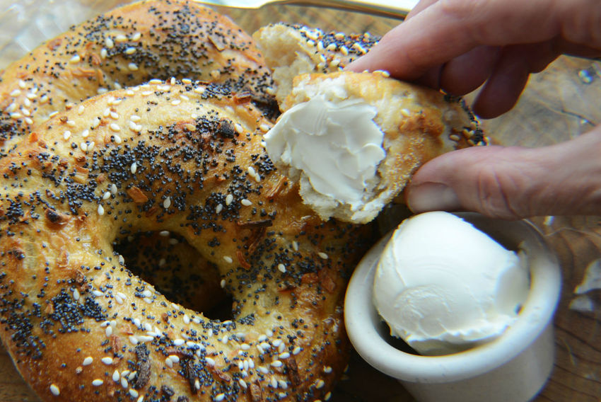 Bagel Bagels Bread Breakfast Brunch Close-up Comfort Food Cream Cheese Eat Finger Food Food Food And Drink Fresh Baked Freshness Holding Human Hand One Person Ready-to-eat