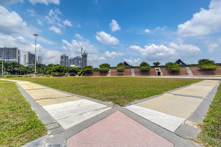 JOHOR BAHRU, MALAYSIA - August 3rd , 2017 :Kota Iskandar main building. Kota Iskandar is an administrative centre for the state government of Johor, Malaysia. Architecture Building Building Exterior Built Structure City Cloud - Sky Day Field Footpath Grass Green Color Lawn Nature No People Office Building Exterior Outdoors Plant Sky Sunlight Tree