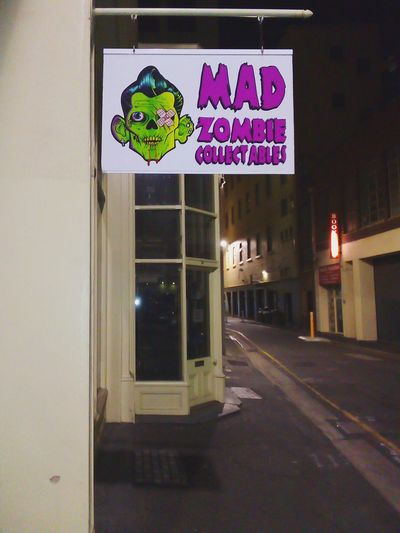GreenFaces Male Likeness I'm Gonna Gouge Your Eyes Out Mad Mad Zombie Night Commercial Signs Sign SIGN. Street Street Photography Adelaide Taking Photos No People Check This Out Zombies  MadZombie Madzombie.com.au Human Representation Zombie Night Streetphotography Nightphotography Text Architecture Information Signboard Information Sign Western Script Sign