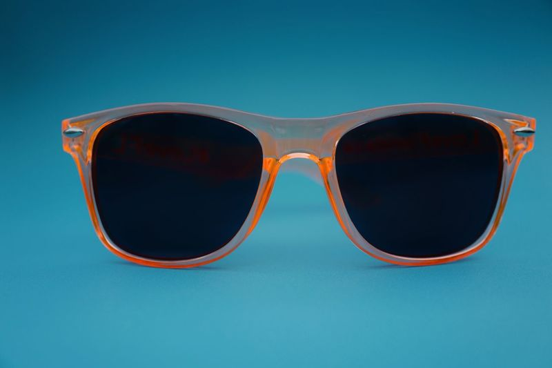 Love wearing it in summer Style Fashion Sunglass  Style And Fashion Stylish Orange Color Glasses Blue Fashion Sunglasses No People Colored Background Personal Accessory Close-up Single Object Still Life Blue Background Eyeglasses  Eyewear Protection