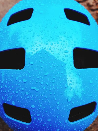 Raindrops on blue helmet Blue Bright Helmet Water Backgrounds Blue Full Frame Drop Pattern Close-up Wet