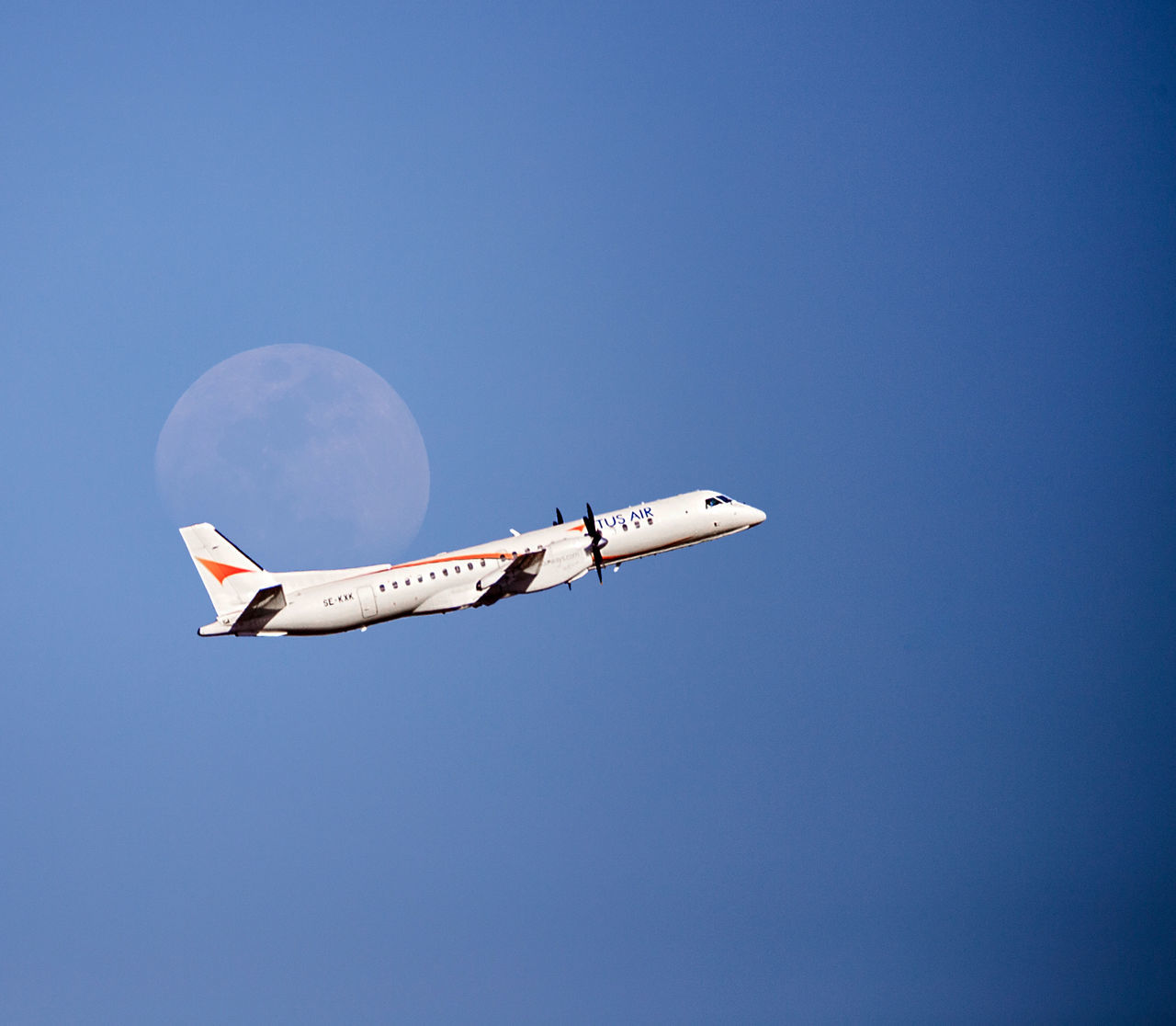 copy space, clear sky, airplane, blue, flying, journey, low angle view, adventure, moon, air vehicle, day, outdoors, no people, nature, sky