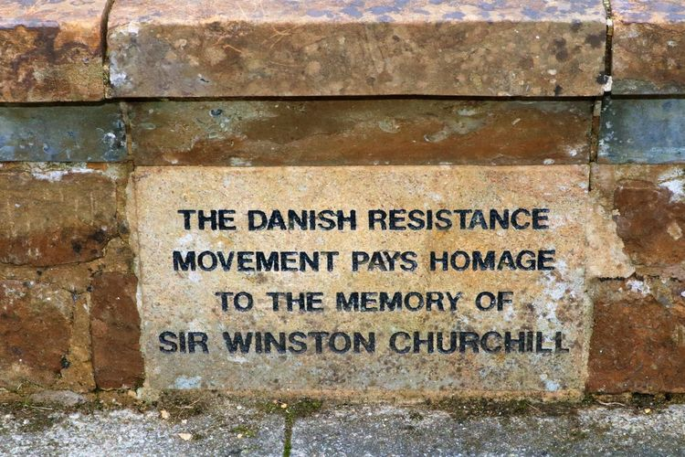 The Danish Resistance Movement Plaque Bladon Danish Resistance Movement Sir Winston Churchill Architecture Built Structure Close-up Day History Memory No People Outdoors Oxfordshire Plaque Stone Text