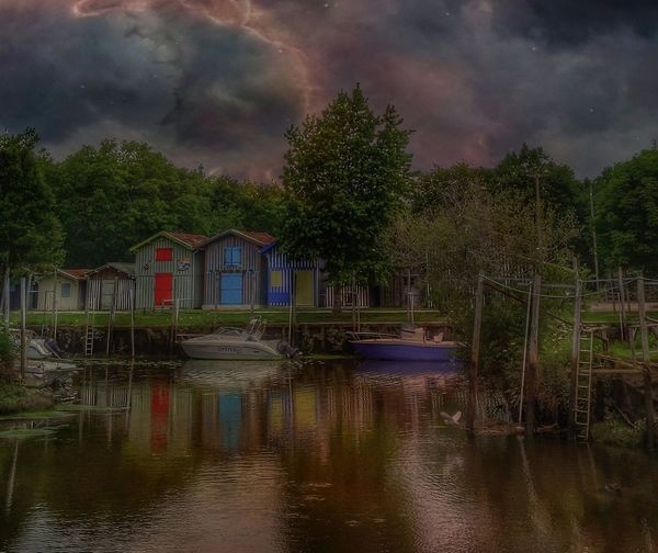 Big Storm Storm Cloud Cloud - Sky EyeEm Gallery Eye4photography  Thunderstorm Tree Water Nautical Vessel Multi Colored Reflection Sky Architecture Cloud - Sky Built Structure Lakeside Lakeshore Residential Structure Country House