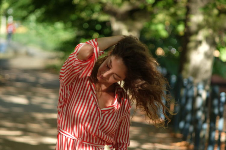 summer stroll model Julia Bond Beautiful Woman Brown Hair Casual Clothing Day Emotion Focus On Foreground Hair Hairstyle Happiness Leisure Activity Lifestyles Long Hair One Person Outdoors Real People Smiling Striped Teenager Waist Up Wind Young Adult Young Women