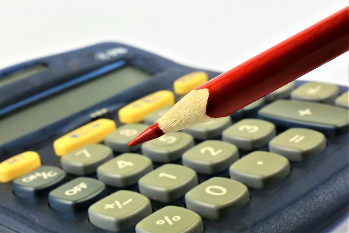 An concept image of a calculator with a pencil and copy space Business Office Work Abstract Business Finance And Industry Calculation Calculator Close-up Concept Day Finance Indoors  No People Pen Pencil Red Pen Red Pencil Tax