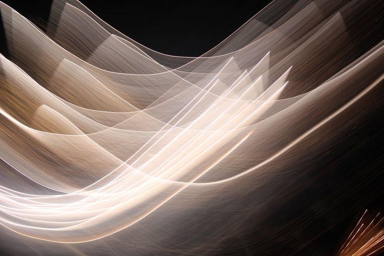 Full frame shot of illuminated light trails at night