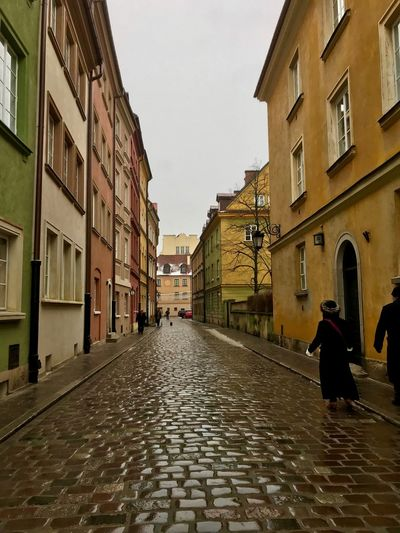 Warsaw in winter Warsaw Building Exterior Architecture Built Structure City Building Street Sky The Way Forward Residential District Wet Day Real People Walking Outdoors