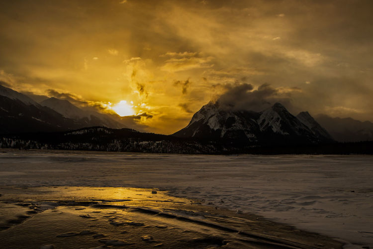 Beauty In Nature Cloud - Sky Cold Temperature Day Dramatic Sky Ice Landscape Mountain Nature No People Outdoors Scenics Sky Snow Storm Cloud Sunset Tranquil Scene Tranquility Water Weather Winter