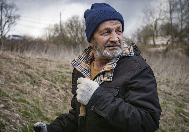 Portrait of man wearing hat on field during winter