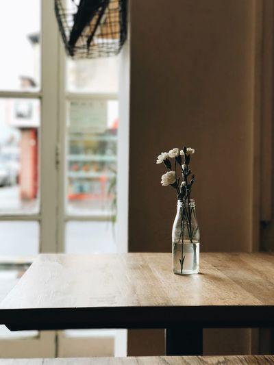 Flower Vase On Table In Cafe