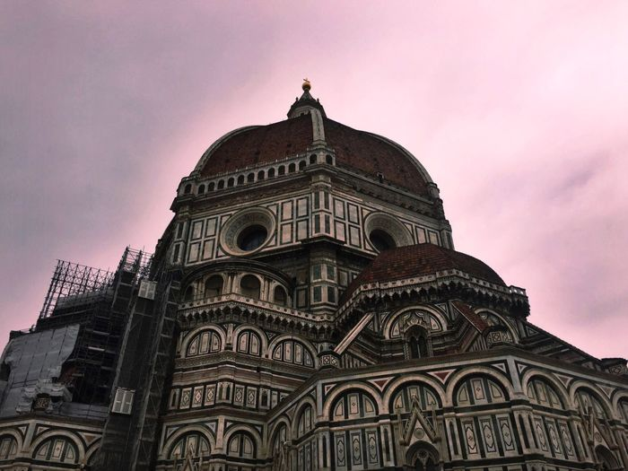Low angle view of florence cathedral against sky during sunset