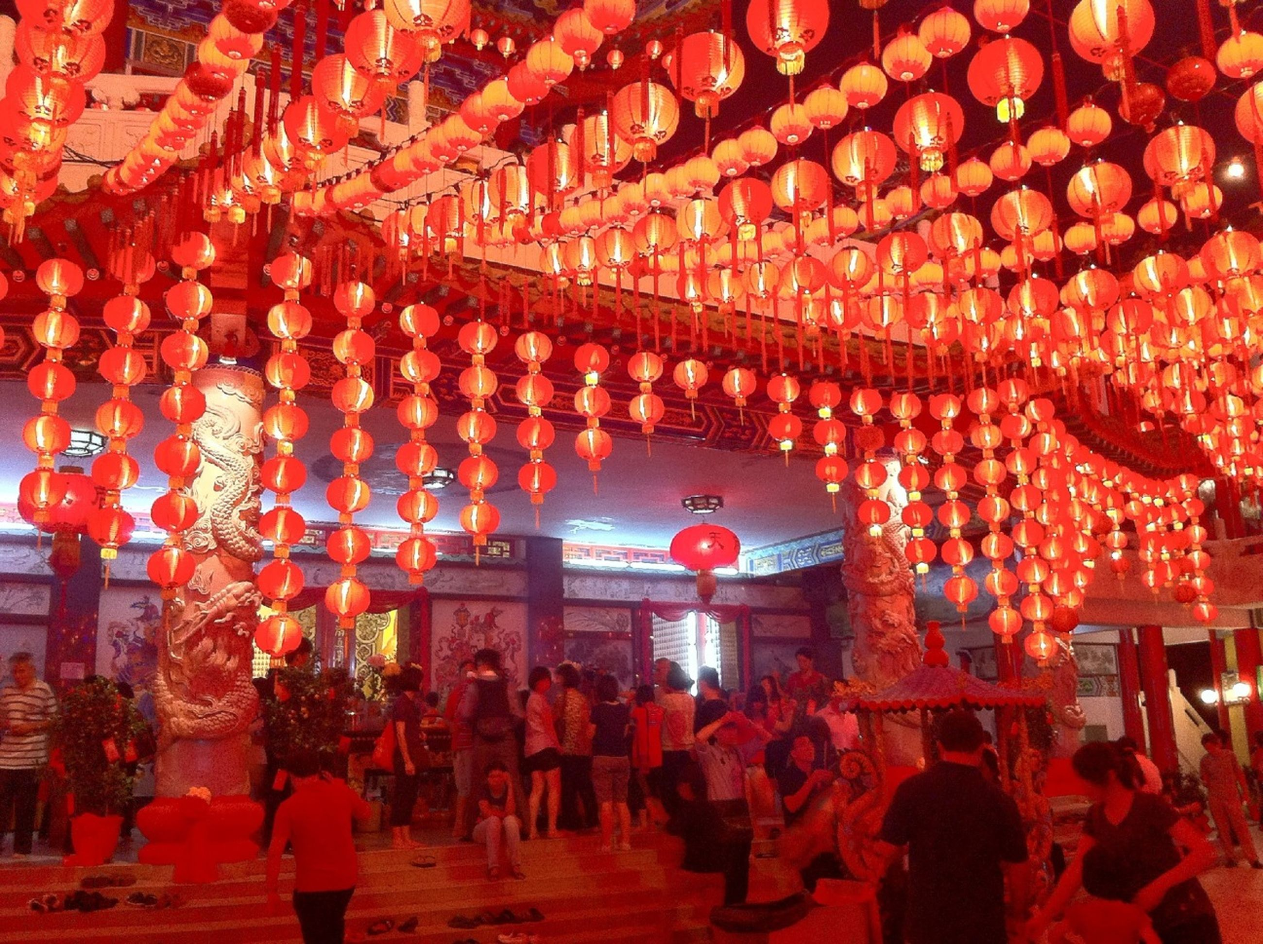 large group of people, illuminated, red, person, lifestyles, men, celebration, tradition, leisure activity, night, cultures, crowd, built structure, architecture, lighting equipment, lantern, decoration, culture, hanging