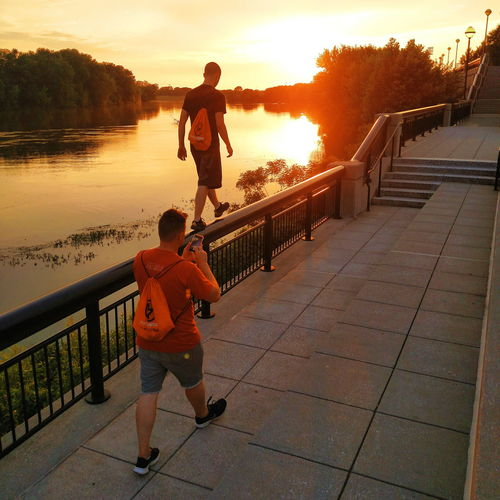 Let's Go. Together. Two People Full Length Walking Sunset Real People Outdoors Men People Boys Water Lifestyles Togetherness Day Sky Friendship Nature Tree Adult Child Young Adult Parkour Yim Youth In Mission