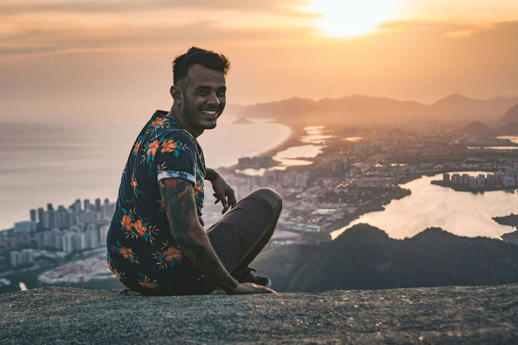 Portrait of Ruggeri over Barra da Tijuca. Chilling City Cityscape Climbing Day Hanging Out Lake Leisure Activity Lifestyles Men Moody Moody Sky Mountain Mountain Range One Person Outdoors Panorama People Real People Sea Sky Sunset The Portraitist - 2017 EyeEm Awards Young Adult Young Men Neighborhood Map Live For The Story Sommergefühle Lost In The Landscape Connected By Travel An Eye For Travel This Is Masculinity This Is Latin America Focus On The Story Adventures In The City The Portraitist - 2018 EyeEm Awards A New Beginning