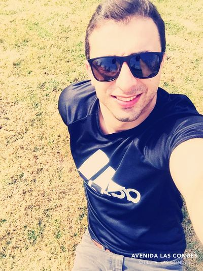 Sunday #smile Glasses One Person Real People Leisure Activity Land Casual Clothing Young Men Day Sunlight Outdoors High Angle View