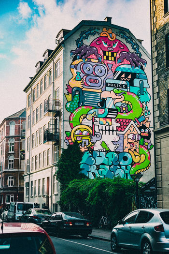 colourful graffiti on a building in Copenhagen, Denmark Architecture Art ArtWork Built Structure Cartoon City City Life Colours Copenhagen Copenhagen, Denmark Day Graffiti Graffiti Art Multi Colored No People Outdoors Sky Street Street Art Text Wall Wall - Building Feature