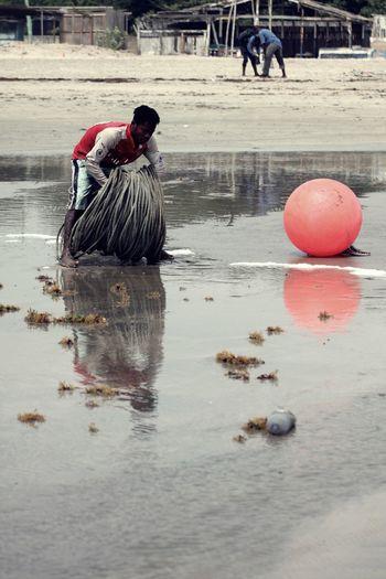 Man working at beach