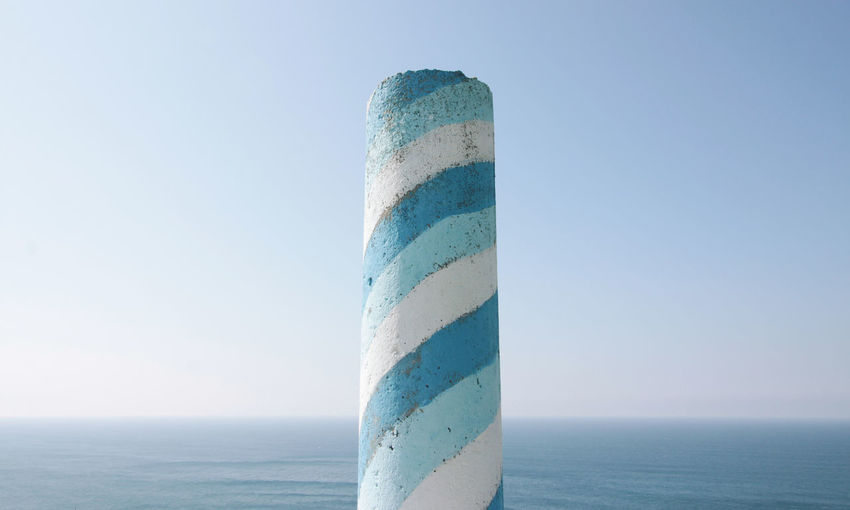 Painted trig point, Oviñana, council of Cudillero, Asturias, Spain. Beach Blue Clear Sky Clear Sky Close-up Copy Space Day Good Weather Horizon Horizon Over Water Lines Minimal Minimalism Nature No People Outdoors Painting Pillar Sea Simplicity Sky Sunny Trig Pillar Trig Point Water
