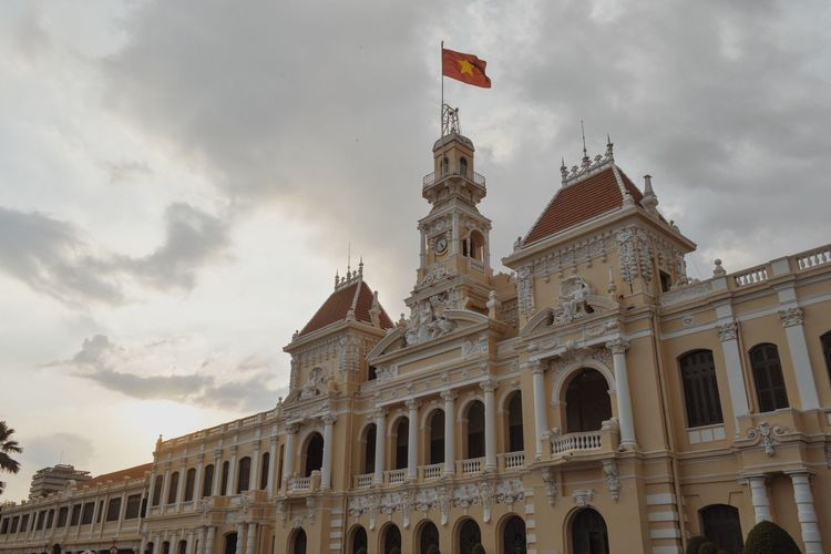 Low angle view of ho chi minh city hall against sky