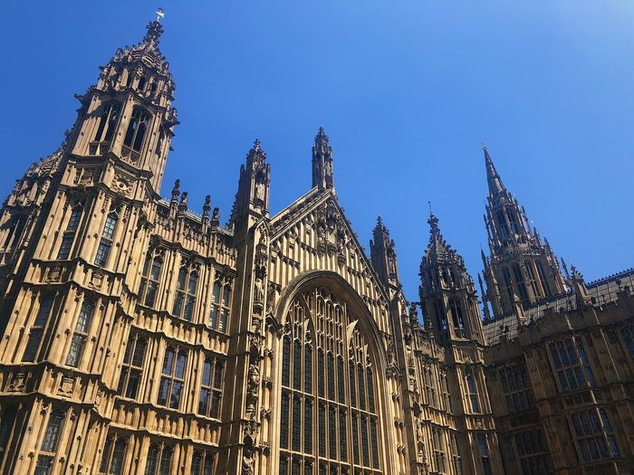 Palace of Westminster London and a Bright summers Parliament architecture in the city Architecture Blue Sky United Kingdom Government Uk Parliament Westminster History London Low Angle View Architecture Building Exterior Built Structure Sky Building Religion Travel Destinations Gothic Style Outdoors Clear Sky Architecture City Government Architecture City Low Angle View Tourism The Past Government Travel 10 #urbanana: The Urban Playground