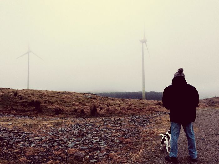 Walking the dog on a Sunday Bryne Stavanger Scandinavia Winter Country Life Dog Walking Dogs Rear View Real People Sky One Person Men Nature Lifestyles Environment Land Standing Turbine Wind Turbine Walking Outdoors