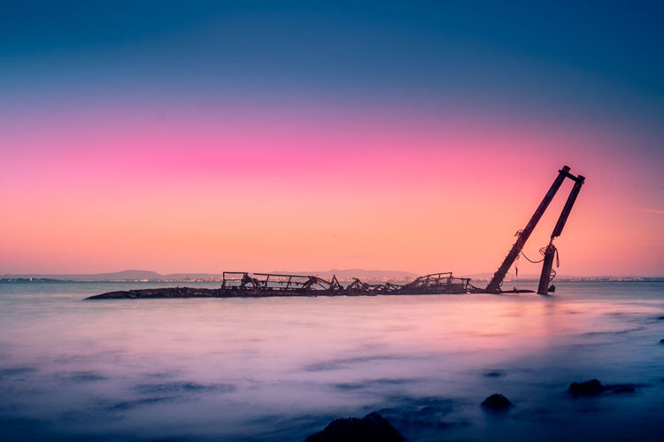 Architecture Beauty In Nature Clear Sky Crane - Construction Machinery Day Nature Nautical Vessel No People Outdoors Scenics Sea Silhouette Sky Sunset Tranquility Transportation Water Waterfront